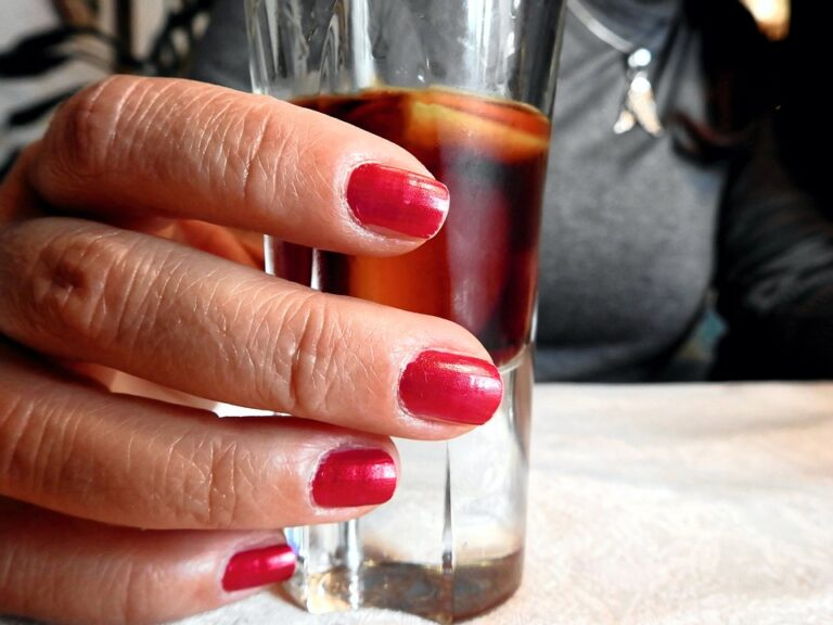 Specialty drink in shotglass - red fingernails