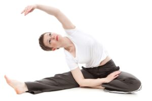 Woman stretching on white background