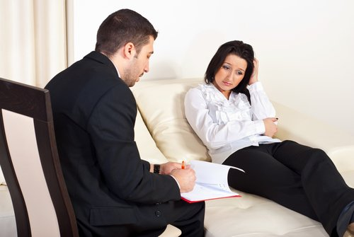 Psychotherapeutic session therapist with thoughtful patient
