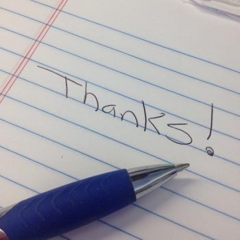 Thanks on notepad with pen