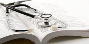 stethoscope on open textbook
