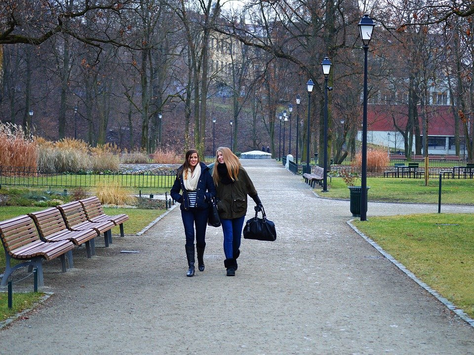 Women walking together in park
