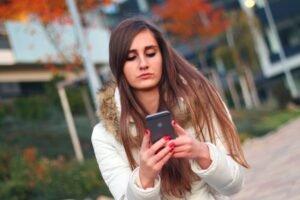 teen girl absorbed in smartphone