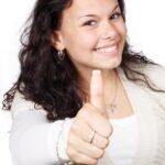 Positive woman giving thumbs up