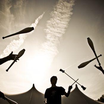 3 jugglers in silhouette - dusk