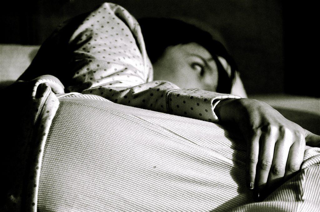 BW insomniac twisting in bed