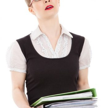 Anxious woman carrying stack of books