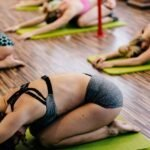 women stretching in yoga class