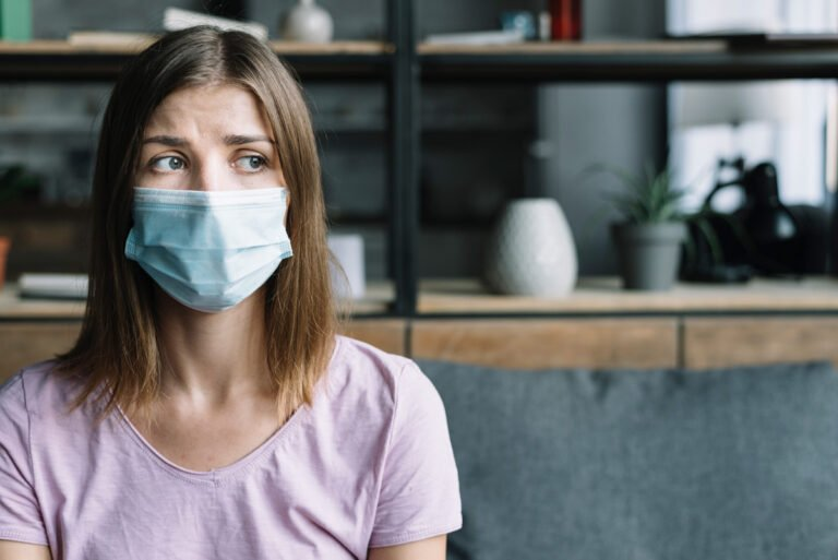 worried woman in respirator mask